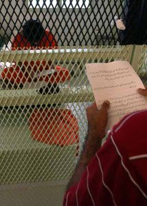 A CSRT Notice is read to a detainee in Guantanamo in July 2004