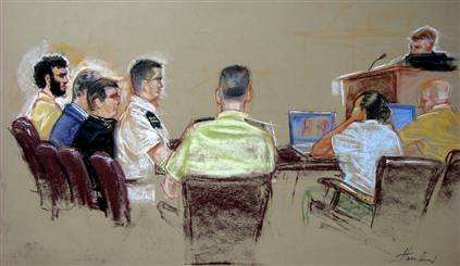 Omar Khadr (left) at his aborted trial in 2007