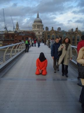 Guantanamo protestor on the Millennium Bridge