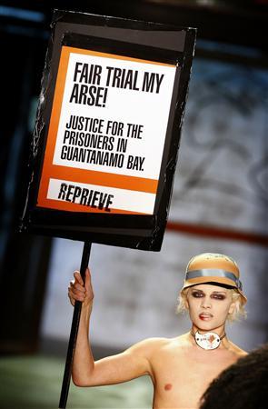 A Vivienne Westwood model protests against Guantanamo
