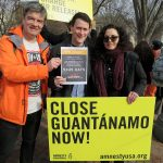 "Andy Worthington of Close Guantánamo with Mitch Robinson, international law expert for Mustafa al-Hawsawi, one of five ""high-value detainees"" at Guantánamo accused of involvement in the 9/11 attacks, and Daphne Eviatar of Amnesty International USA call on Donald Trump to close Guantánamo at the annual rally outside the White House on January 11, 2018, the 16th anniversary of the opening of the prison. They were supporting the new Close Guantánamo initiative, counting how many days Guantánamo has been open — a shocking total of 5,845 days on the anniversary."