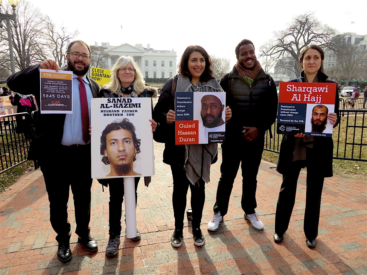 After launching the new lawsuit against Donald Trump, lawyers with the Center for Constitutional Rights came to the White House to join the annual protest against Guantanamo's continued existence (on the left, legal director Baher Azmy, and on the right, Omar Farah and Pardiss Kebriaei. In the center is Advocacy Program Manager Aliya Hussain (Photo: Andy Worthington).