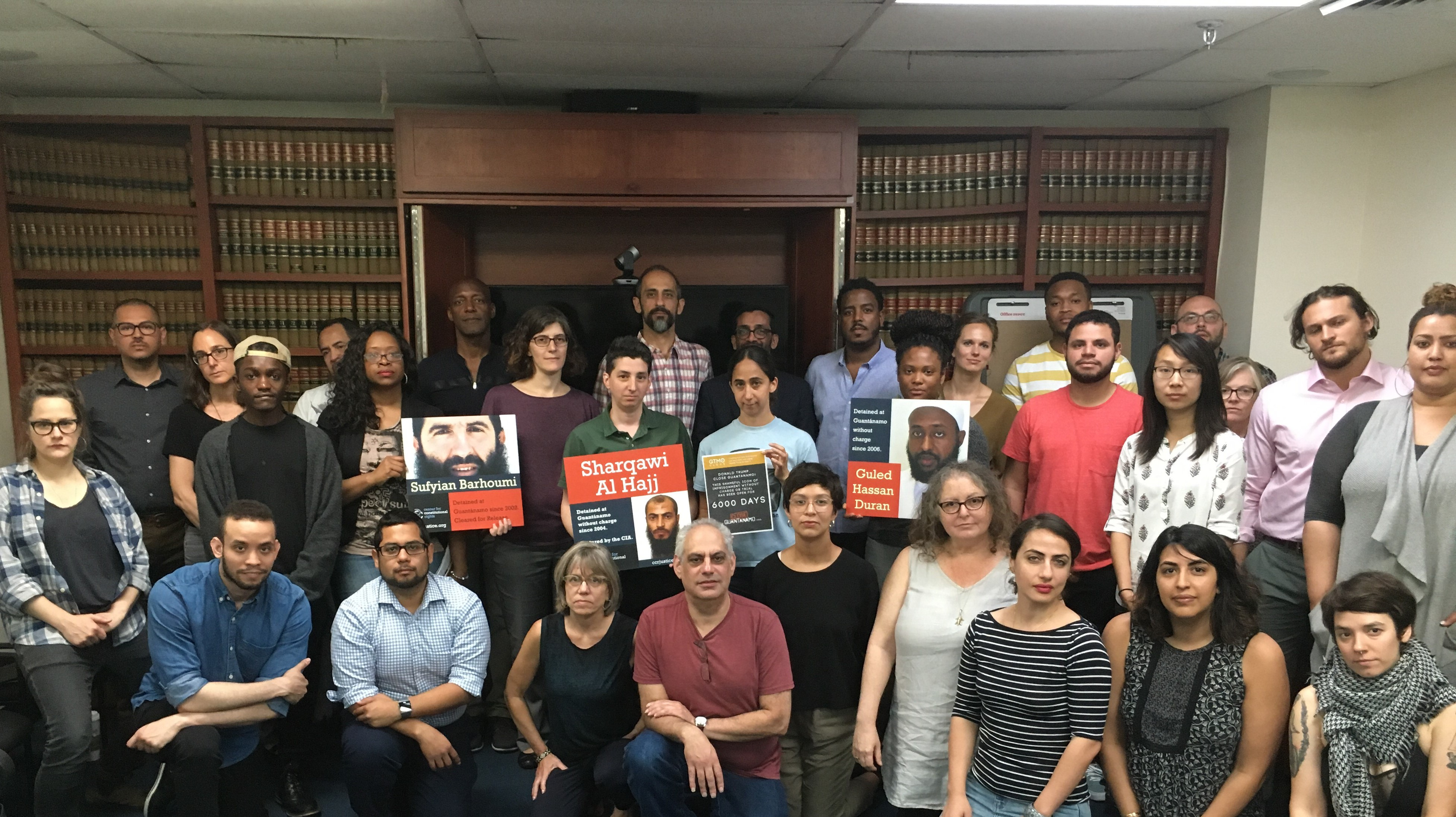 "A great photo of the Center for Constitutional Rights' staff and interns in New York united in calling for the closure of #Guantanamo on its 6,000th day of existence on June 15, 2018. Staff also hold up placards for three prisoners CCR represent: Sufyian Barhoumi, approved for release by a high-level review process under President Obama,but still held, and ""forever prisoners"" Sharqawi al-Hajj and Guled Hassan Duran."