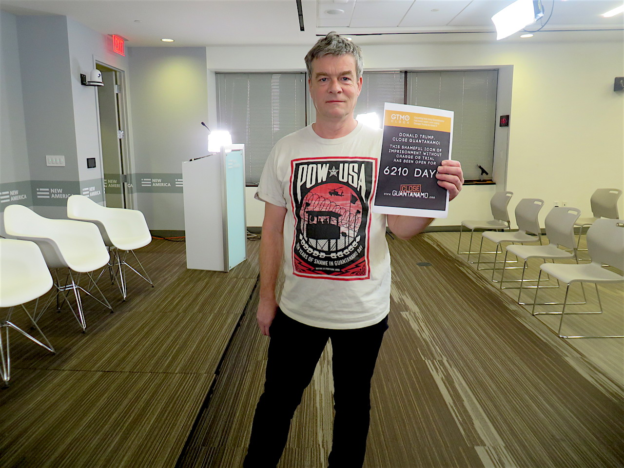 Andy Worthington with a Close Guantanamo poster marking 6,210 days of the prison's existence at New America in Washington, D.C. on January 11, 2019, the 17th anniversary of the prison's opening.