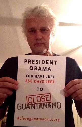 The musician David Knopfler supports the new Countdown to Close Guantanamo campaign, and stands with a poster telling President Obama that, on February 4, 2016, he has just 350 days left to close Guantanamo before he leaves office.