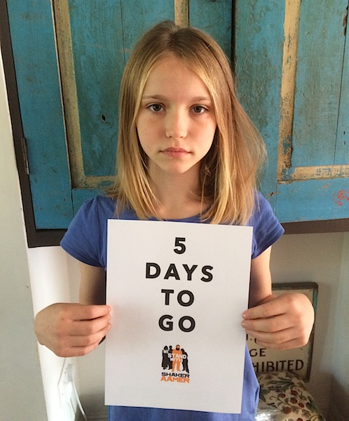 Malila Durant, daughter of We Stand With Shaker co-director Joanne MacInnes, stands with a poster marking the countdown to the hoped-for release of Shaker Aamer from Guantanamo on October 25.
