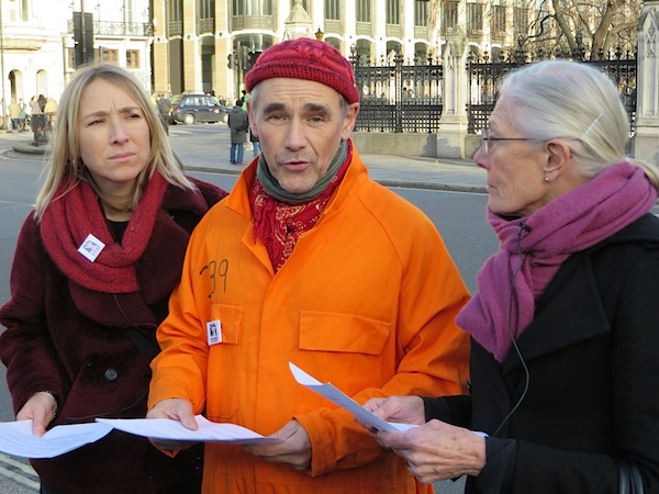 Mark Rylance (C), Vanessa Redgrave (R) and Joanne MacInnes (L) of We Stand With Shaker read out from Shaker Aamer's Declaration of No Human Rights, written in Guantanamo, in Parliament Square on Human Rights Day, December 10, 2014 (Photo: Andy Worthington).