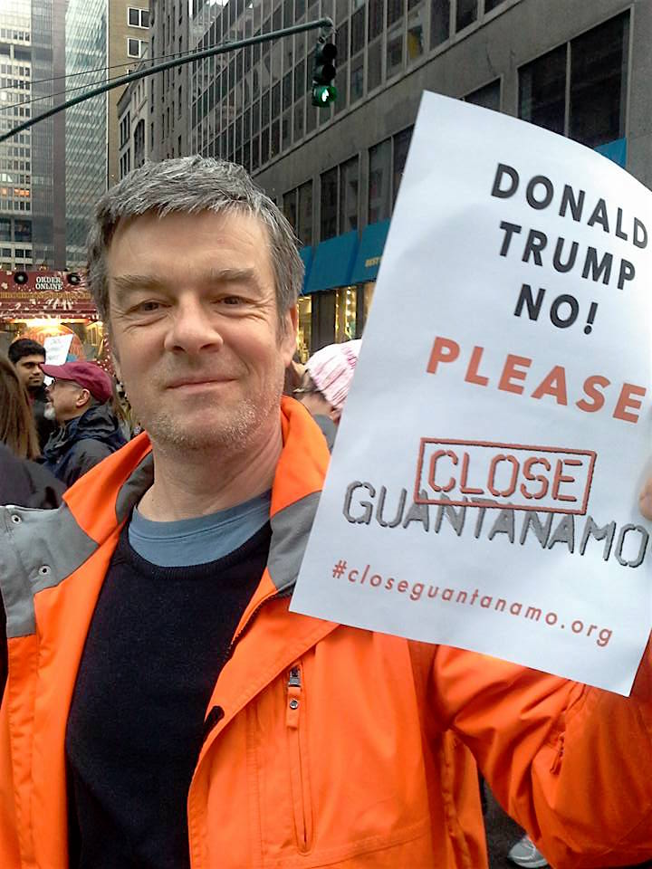 Andy Worthington calls on Donald Trump to close Guantanamo on his first full day in office, Jan. 21, 2017, during the massive women's march against his presidency in New York City.