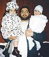 Shaker Aamer and two of his four children