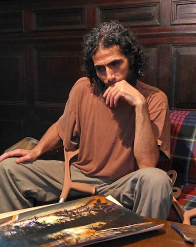 Abu Wa'el Dhiab photographed after his release in Uruguay with a picture he painted after his release (Photo: Oscar Bonilla).