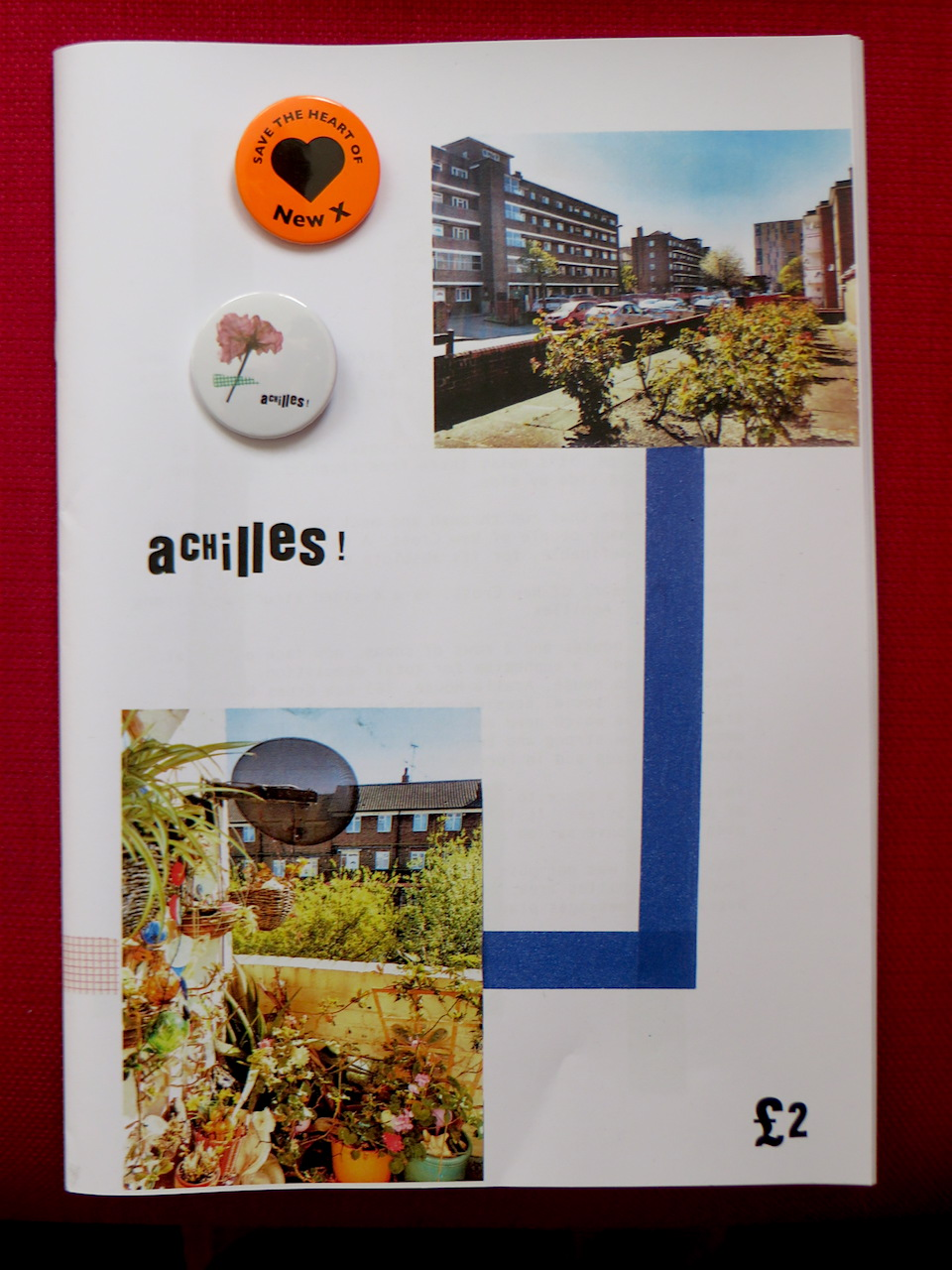 The Achilles fanzine, put together by resident Lilah Francis, from the area threatened with demolition by Lewisham Council, and some campaign badges (Photo: Andy Worthington).