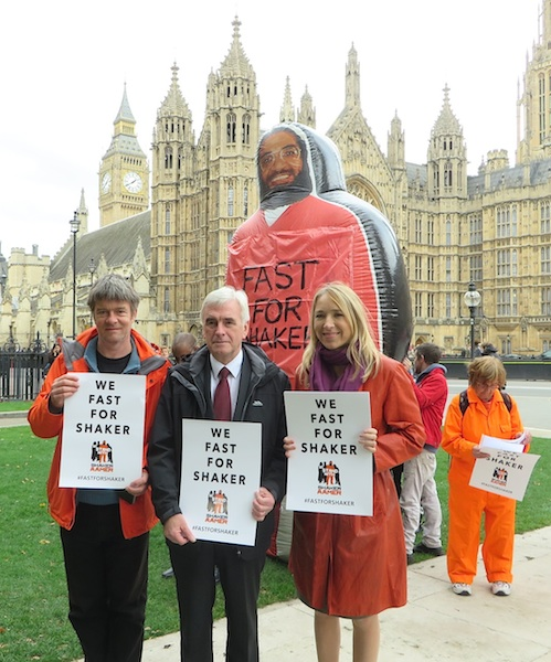 Andy Worthington, the Shadow Chancellor John McDonnell (the founder and co-chair of the All-Party Shaker Aamer Parliamentary Group) and Joanne MacInnes at the launch of Fast For Shaker outside Parliament on October 15, 2015 (Photo: Seb Corbyn for Andy Worthington).