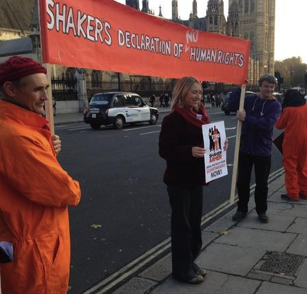 Andy Worthington (R) with the actor-director Mark Rylance (L) and Joanne MacInnes (C) during an event for Shaker Aamer in Parliament Square on December 10, 2014 as part of the We Stand With Shaker campaign (Photo: Benedick Tranchell).