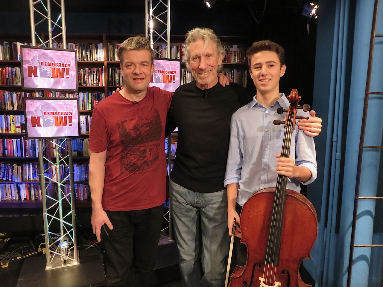 "Andy Worthington, Roger Waters and 16-year old cellist Alexander Rohatyn on Democracy Now! on January 22, 2016. Andy and Roger were launching the Countdown to Close Guantanamo, and Roger and Alexander played Roger's version of ""We Shall Overcome."""