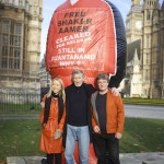 Andy Worthington and Joanne MacInnes of We Stand With Shaker with music legend Roger Waters (ex-Pink Floyd) at the launch of the campaign outside the Houses of Parliament on November 24, 2014 (Photo: Stefano Massimo).