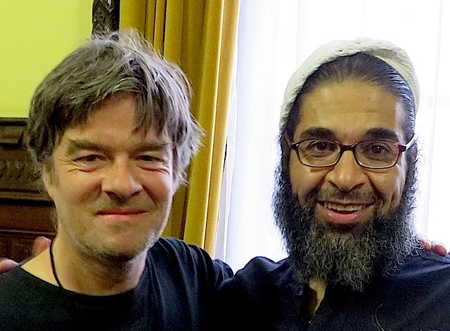 Andy Worthington with Shaker Aamer, after his release from Guantanamo, at a meeting in the House of Commons in November 2015.