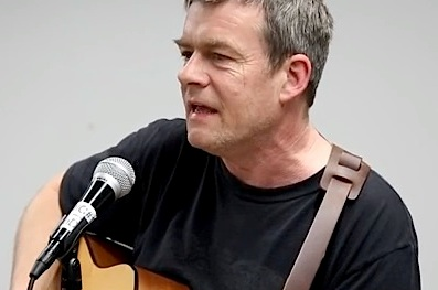 "Andy Worthington singing ""Song for Shaker Aamer"" at ""Visions of Homecoming: Close Guantanamo!"" an event in Washington, D.C. on January 10, 2016, put together by Witness Against Torture and Code Pink (Screen grab from the video by Justin Norman)."