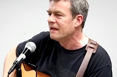 Andy Worthington singing his 'Song for Shaker Aamer' at an event in Washington, D.C. on January 10, 2016, the day before the 14th anniversary of the opening of Guantanamo (Photo: Justin Norman).