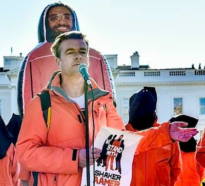 Andy Worthington calling for the closure of Guantanamo outside the White House on January 11, 2016, the 14th anniversary of the opening of the prison. Behind him is the giant inflatable figure of Shaker Aamer that was at the heart of the We Stand With Shaker campaign (Photo: Justin Norman).