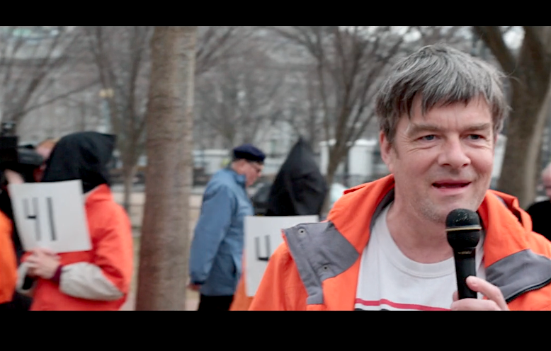 A screenshot of Andy Worthington calling for the closure of Guantanamo outside the White House on January 11, 2018.