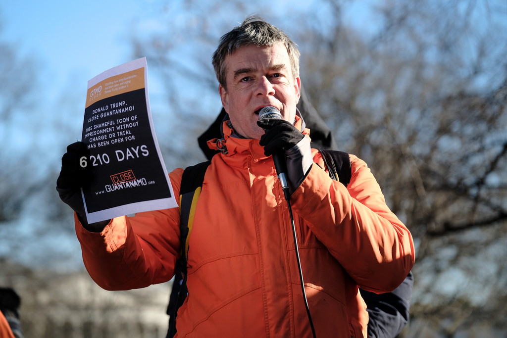 Andy Worthington photographed outside the White House calling for the closure of Guantanamo on January 11, 2019, the 17th anniversary of the opening of the prison; or, to put it another way, when it had been open for 6,210 days (Photo: Steve Pavey for Witness Against Torture).