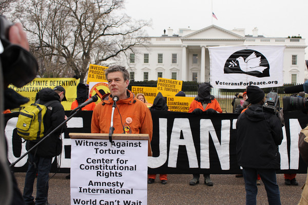 Andy Worthington calls on President Obama to close Guantanamo at a rally outside The White House on January 11, 2011 (Photo by Sarah K. Hogarth).