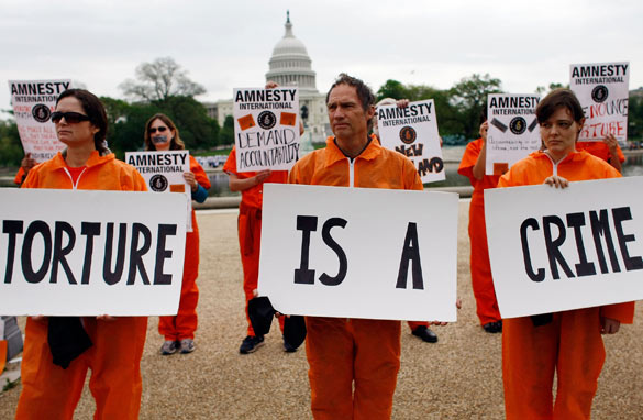 Anti-torture protestors outside the White House in May 2009, after President Obama's first 100 days in office.