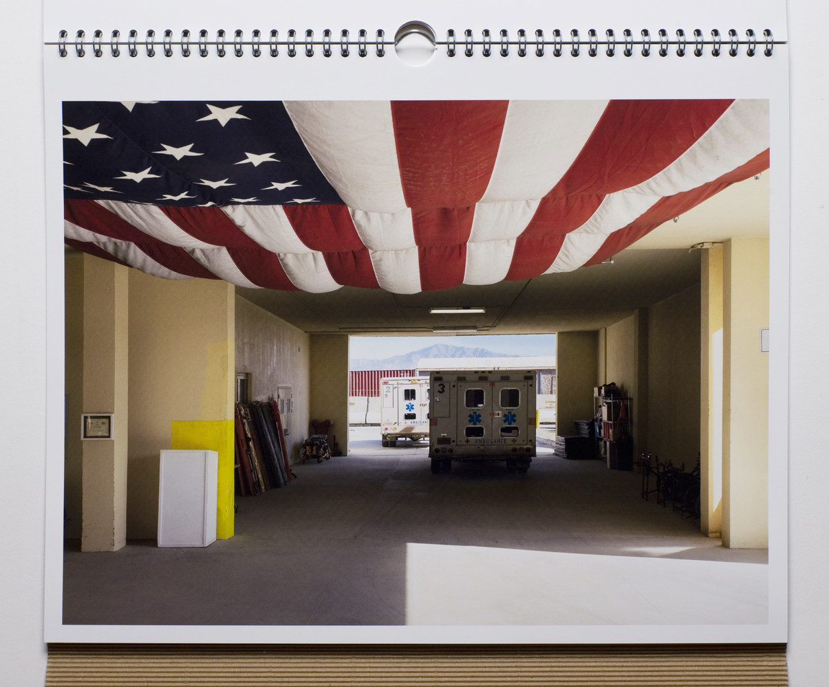 "Bagram and a huge US flag"" a photo by Edmund Clark from his project 'The Mountains of Majeed.'"