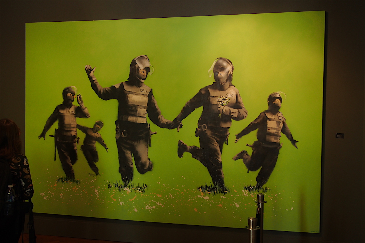 'Beanfield', a 2009 work by Banksy, photographed in MOCO Museum in Amsterdam, where it is on display until August 2017 (photo via the website Rajah's 2 Cents).