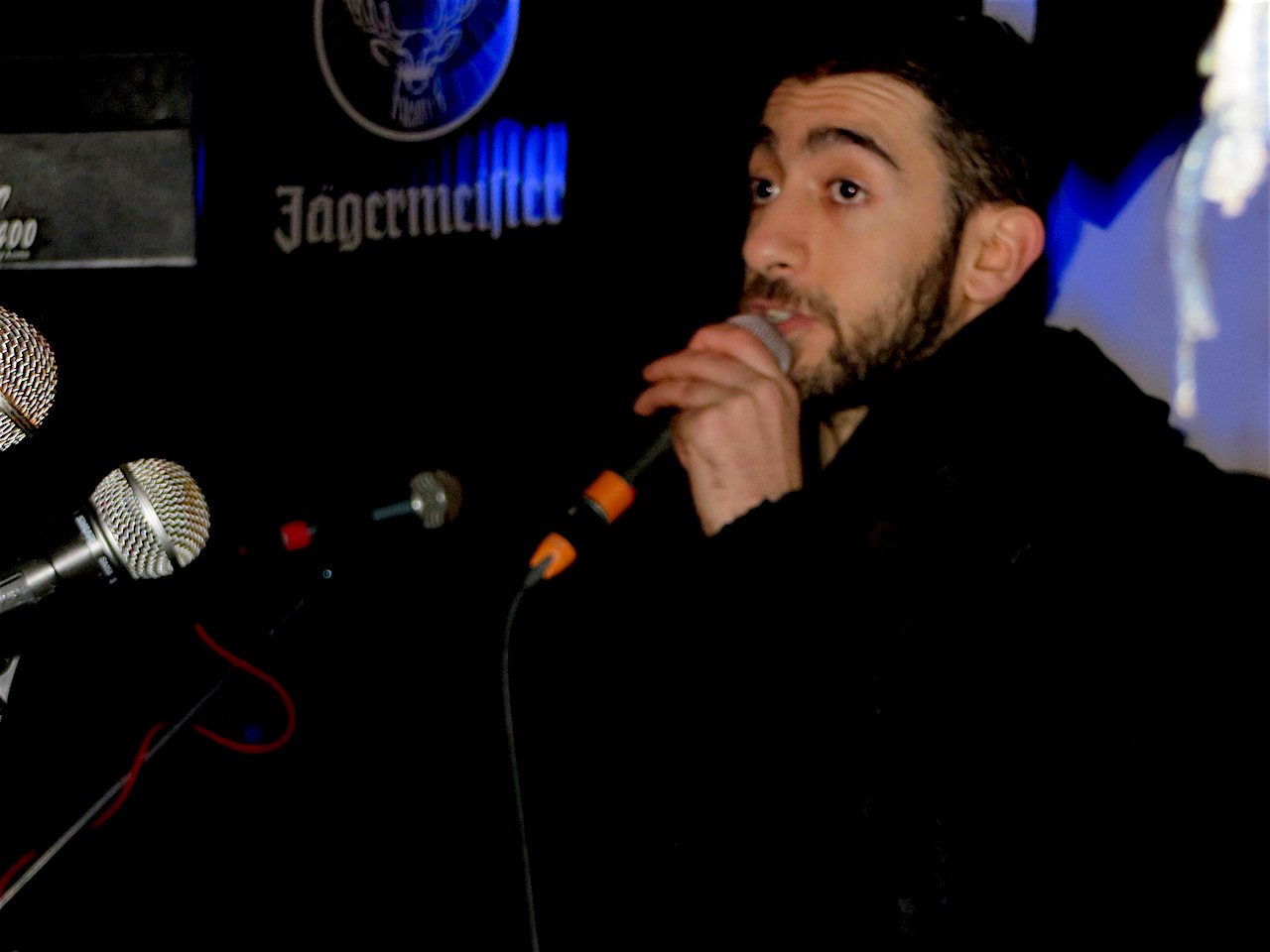 Spoken word artist Potent Whisper performing at 'No Social Cleansing in Lewisham' at the Birds Nest pub in Deptford on November 12, 2017 (Photo: Andy Worthington).