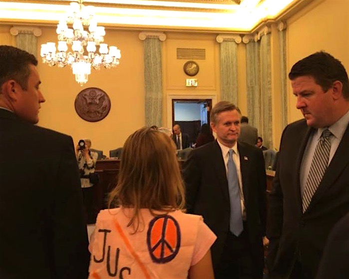 """Medea Benjamin of CODEPINK: Women for Peace challenges Steven G. Bradbury over his role as a """"torture memo"""" author at his confirmation hearing as a Trump administration lawyer on June 28, 2017."""