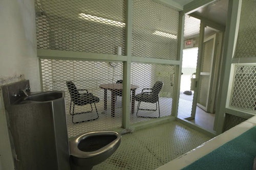 The meeting room in Camp Echo, mentioned in Guantanamo commander Rear Adm. Cozad's May 2015 memo prohibiting lawyers from bringing food into meetings with the clients, as seen from one of the cells. Camp Echo is where prisoners used to be held in isolation.