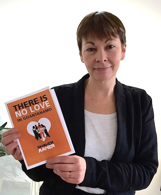 "Caroline Lucas MP (Green, Brighton Pavilion) supporting the We Stand With Shaker campaign in February 2015, with a poster for Valentine's Day declaring, ""There is no love in Guantanamo."" In March 2016, Caroline launched a new Early Day Motion calling for the closure of Guantanamo."