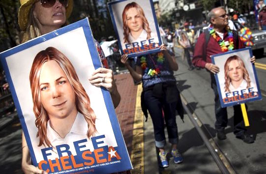 Protestors holding signs calling for the release of Chelsea Manning during a gay pride parade in San Francisco in 2015 (Photo: Elijah Nouvelage/Reuters via ZUMA Press).