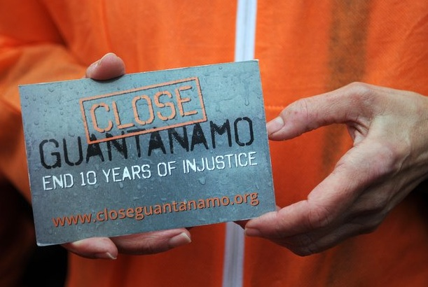 """Close Guantanamo"": a campaigner holds a postcard promoting the ""Close Guantanamo"" campaign on January 11, 2012 in Washington D.C., the 10th anniversary of the opening of Guantanamo."