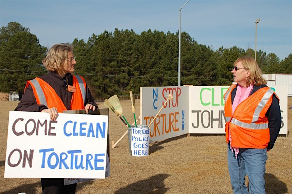 Christina Cowger and Allyson Caison of North Carolina Stop Torture Now protesting against Aero Contractors, who flew rendition flights for the CIA's torture program, in January 2013. Cowger is now part of the North Carolina Commission of Inquiry on Torture (Photo: Bob Geary).