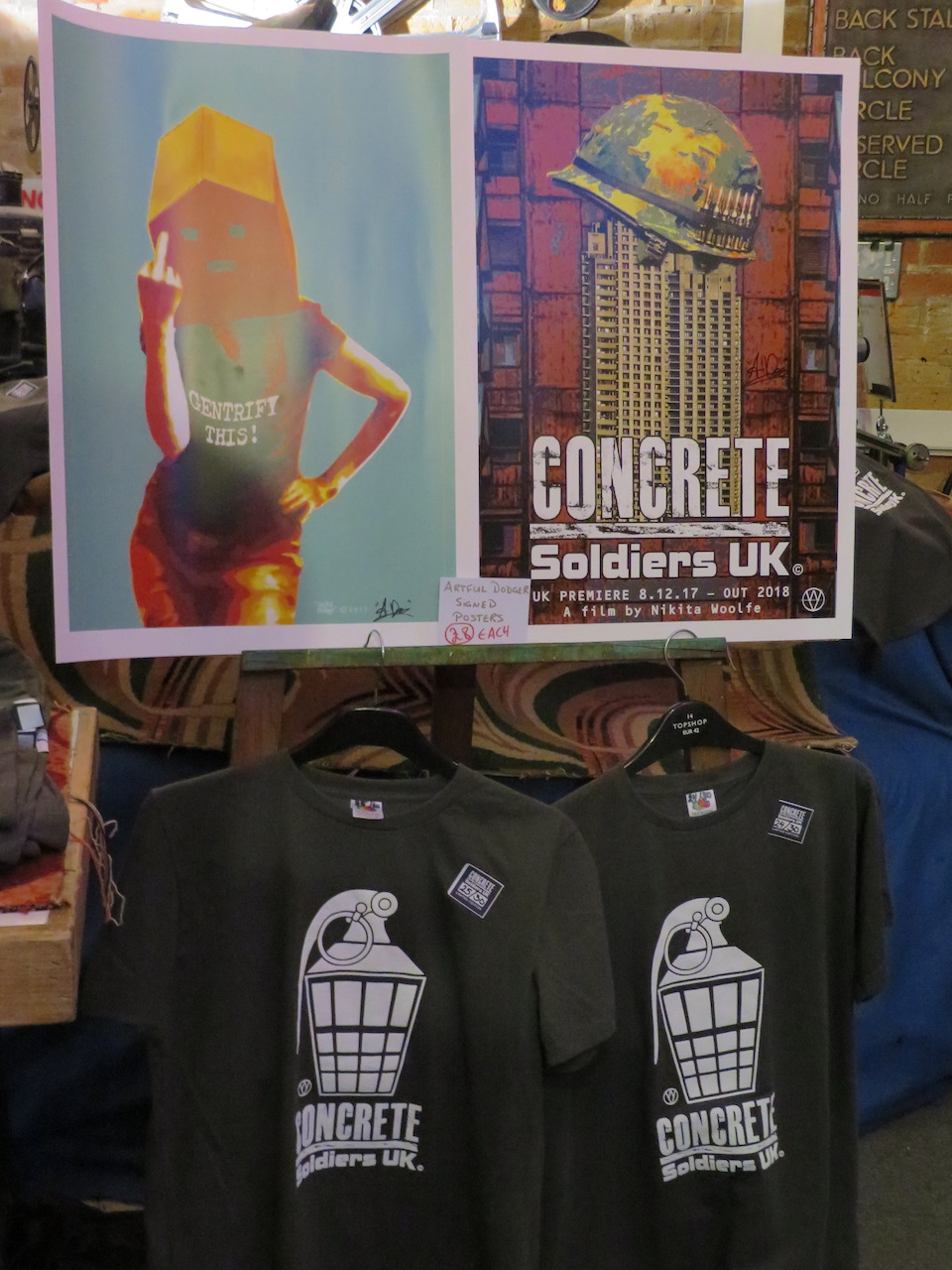 Merchandise - posters and T-shirts, based on designs by artist Artful Dodger - for the documentary film 'Concrete Soldiers UK', which had its world premiere at the Cinema Museum in Kennington, London SE11 on Friday December 8, 2017.