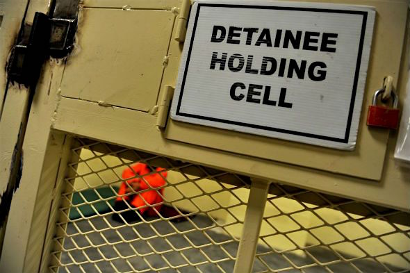"""Detainee Holding Cell"": a US military sign, origin unknown."