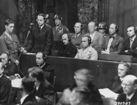 "A photo from the Einsatzgruppen (mobile SS death squad) trial as part of the Nuremberg trials on September 15, 1947, at which Benjamin Ferencz, the last surviving Nuremberg prosecutor, was the chief prosecutor, at the age of 27. Standing is Otto Ohlendorf, the commander of one of the detah squads, delivering a plea of ""not guilty."" He was subsequently found guilty, and hanged."