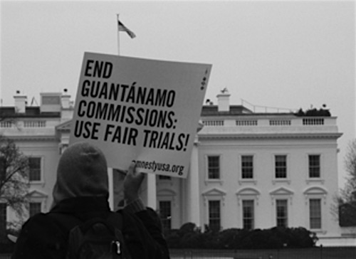 """End Guantanamo commissions: use fair trials"" - an Amnesty International supporter outside the White House."