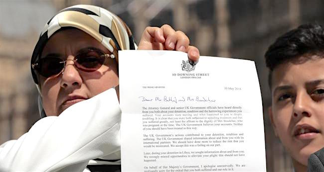 Fatima Boudchar holds up the letter to her and her husband, Abdel Hakim Belhaj, from British Prime Minister Theresa May, apologising unreservedly for the UK's role in their abduction and rendition to Libya in 2004.