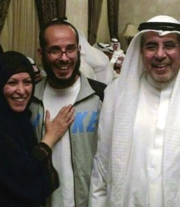 In this photo released by the al-Odah family, Fawzi al-Odah is shown with an unidentified relative on the left and his father Khalid on the right on his arrival in Kuwait on November 6, 2014.