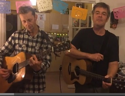 Richard Clare and Andy Worthington of The Four Fathers play '81 Million Dollars', Andy's song about the US torture program, in a screenshot from a video.