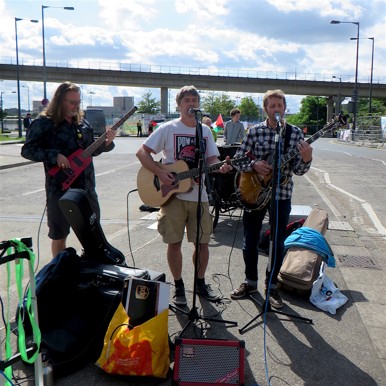Mark Quiney, Andy Worthington and Richard Clare of The Four Fathers playing at a protest against the DSEI arms fair in London's Docklands in September 2017.