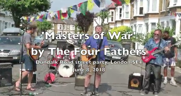 Screenshot from the video of The Four Fathers playing 'Masters of War' at a street party in June 2018.