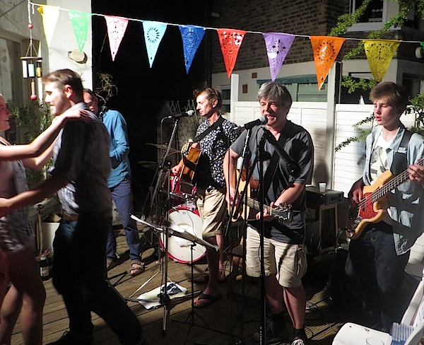 Andy Worthington's band The Four Fathers playing at a party in London in July 2015.