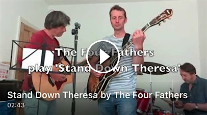 A screenshot from the video of The Four Fathers playing 'Stand Down Theresa', a version of The Beat's protest classic, 'Stand Down Margaret.'