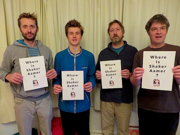 "Andy Worthington's band The Four Fathers ask, ""Where is Shaker Aamer?"" on the evening of October 27, 2015. From L to R: Richard Clare, Louis Sills-Clare, Bren Horstead and Andy Worthington."
