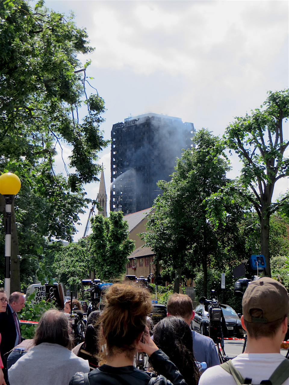 Grenfell Tower, photographed on the afternoon of June 14, 2017, about 12 hours after the inferno began (Photo: Andy Worthington).