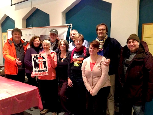 "A photo taken at the Chicago Coalition to Shut Down Guantanamo's event in Chicago on January 15, 2015 with Andy Worthington, Candace Gorman, and Debra Sweet (first, second, and fifth from left). The group also includes (L to R) CCSDG regulars Barbara Lyons, Jerry Parker, Mario Vanegas, Jay Becker, Marie Shebeck, Joe Scarry, and Eldon Grossman. Barbara holds a poster from the ""We Stand with Shaker Aamer"" campaign. (Photo: Lina Thorne.)"
